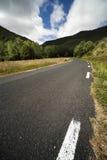 Narrow mountain road in spring Royalty Free Stock Photos