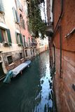 Narrow navigable canal in Venice in Italy. Very narrow navigable canal in Venice in Italy with boat Stock Photos