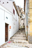 Narrow old cobbled street in a village Royalty Free Stock Photo