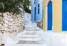 Narrow old colored streets of greek island Royalty Free Stock Photo
