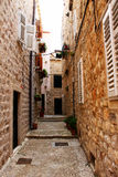 Narrow old pathway stone buildings. Narrow old pathway with stone buildings in Dubrovnik, Croatia royalty free stock images