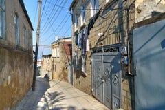 Narrow old street in Derbent city. Stock Photo