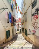 A narrow old street. Lisbon, Portugal. stock images