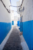 Narrow old street with painted blue walls Royalty Free Stock Photography