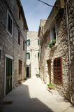 Narrow old street in stone, Croatia Royalty Free Stock Photos