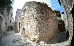 Narrow old street in stone, Croatia Royalty Free Stock Photography