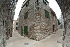 Narrow old street in stone, Croatia. Old narrow street in stone, Croatia Stock Photos