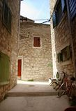 Narrow old street in stone, Croatia Stock Photo