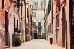 A narrow, old street in Venice, Italy Royalty Free Stock Photo