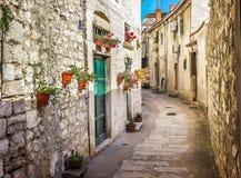 Narrow old street and yard in Sibenik city. Croatia, medieval zone Royalty Free Stock Photo