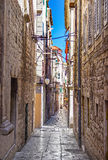 Narrow old streets and yards in Sibenik city, Croatia Royalty Free Stock Photo