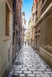 Narrow old streets and yards in Sibenik city, Croatia Royalty Free Stock Image