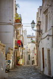 Narrow old urban street in italian town Royalty Free Stock Photo