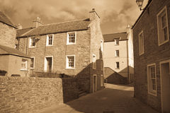 Narrow Orkney street. Narrow street in the town of Stromness, Orkney, Scotland Stock Photo