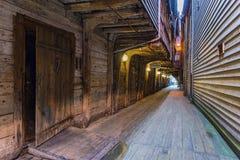 Narrow passage in Bryggen district, Bergen. Bergen, Norway - August 14, 2016: A Narrow passage in the Bryggen district. Is a series of Hanseatic commercial Stock Photos