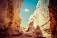 Narrow passage among high rocks in a canyon. Makhtesh Ramon, Neg Stock Photo