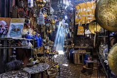 Narrow passage in the Marrakesh Souq, Morocco. Marrakech, Morocco - December 30, 2017: A Narrow passage in the Souk Haddadine. A souq or souk is a marketplace or stock image