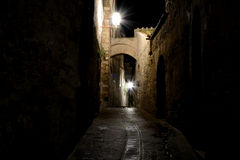 Narrow passage at night in San Gimignano, Italy Royalty Free Stock Photo