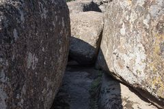 The narrow passage between stones. Shadow falling on a boulder. Learning new paths royalty free stock photos