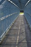 Narrow path. Surrounded with iron fencing Stock Images