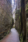The narrow path among high rocks Stock Images