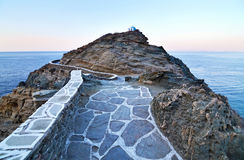 Narrow path that leads at the church of Seven Martyrs Sifnos Greece stock photos