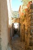 The narrow path at Pigna on Corsica island Royalty Free Stock Image