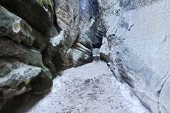 Narrow path through sandstone boulders Stock Images