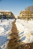The narrow path among the snow drifts in the main street of Bulgarian Pomorie, 2017 Royalty Free Stock Photos