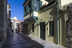 Narrow paved alley with traditional colorful houses at the center of Heraklion city stock photos