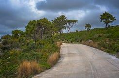Road through the Zante Island. Narrow paved road leading towards the coast and shore on Zante Island, Greece royalty free stock photography