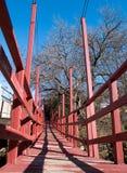 Narrow pedestrian bridge Stock Photography