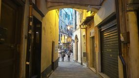 A narrow pedestrian street with in the old european town. SANREMO, ITALY - MARCH 29, 2018: A narrow pedestrian street in the old town of Sanremo late at night stock video