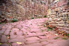 Narrow pink stone alley stock photography