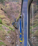 Narrow point. Train between Cusco and Aguas Calientes, Peru - Aguas Calientes is the station for visitors of the ruins of Machupicchu Royalty Free Stock Photography