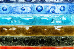 Narrow rectangular strips of artistic glass. Multicolored Stock Photo