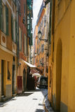 Narrow residential street in old city of Nice Stock Images