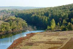 Narrow river, dry meadow and forest near Novosil Stock Photos