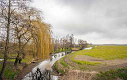 Narrow river meanders diagonally through the countryside Royalty Free Stock Photo