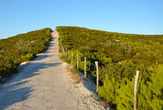 The narrow road across the top of the hill Stock Photo