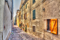Narrow road in Alghero old town Stock Photo