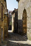 A Narrow Road in Groznjan. A narrow cobblestone road in the old historical city of Groznjan in Istria, Croatia Stock Photos