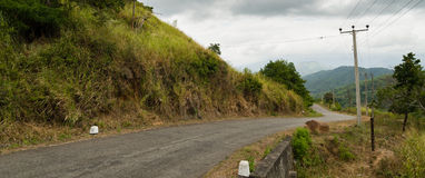 Narrow Road in Hilly Tropical Landscape Stock Photography