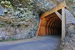 Narrow road and mountain tunnel Royalty Free Stock Photos