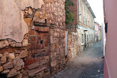 Narrow road between old damaged stone houses Royalty Free Stock Photography