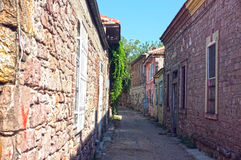 Narrow road between old stone houses Stock Image