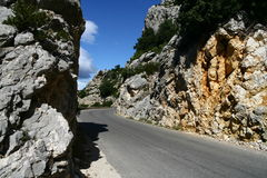 Narrow road through the rocks. In France Royalty Free Stock Photo
