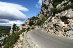 Narrow road by the rocks. Narrow road through the rocks in France stock photo