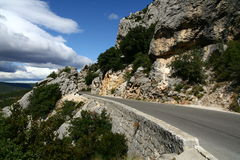 Narrow road by the rocks Royalty Free Stock Photo