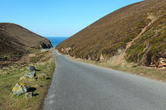 Narrow road to Chapel Porth beach in Cornwall UK. Royalty Free Stock Images